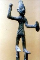 Bronze figure of Baal holding thunder and lightning